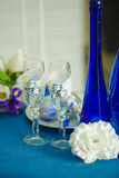 Bridal bouquet of blue iris white tulips glasses and bottles Stock Photography