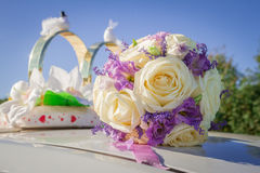 Bridal bouquet on a blurred background. Bridal bouquet on car roof Stock Images