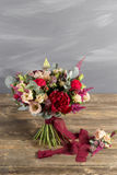 Bridal bouquet and boutonniere. Red and peach color flowers Stock Photo