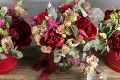 Bridal bouquet and boutonniere. Red and peach color flowers Stock Photography