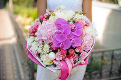Bridal bouquet and bride close up no face Royalty Free Stock Photography