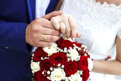 Bridal bouquet. Bride and groom holding hands Royalty Free Stock Photo