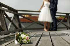 Bridal bouquet with bride and groom Royalty Free Stock Photos