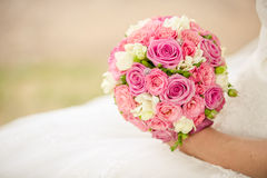 Bridal bouquet. In bride hands Royalty Free Stock Image