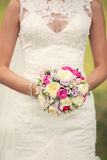 Bridal bouquet. The bride holding a bouquet on the nature Stock Images