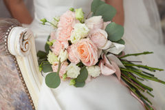Bridal bouquet. The bride holding a bouquet of roses Royalty Free Stock Image