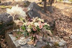 Bridal bouquet. The bride's bouquet. Beautiful bouquet of white, Stock Photo