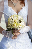 Bridal bouquet  in the the bride's hands Stock Photography