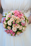 Bridal bouquet  in the the bride's hands Stock Photo