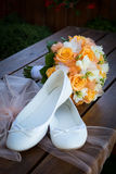 Bridal bouquet and bride's shoes Royalty Free Stock Images