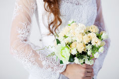Bridal bouquet. Bride in wedding dress, white. Beautiful smiling woman in a wedding dress Royalty Free Stock Photo