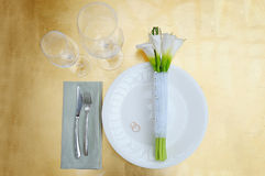 Bridal bouquet of calla lilies on a table on a plate Stock Images