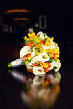 Bridal bouquet with callas on a table Stock Photo