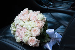 Bridal bouquet in the car Stock Photography