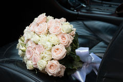 Bridal bouquet in the car Royalty Free Stock Photo