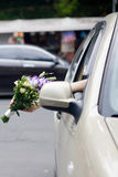 Bridal bouquet in a car window Stock Images