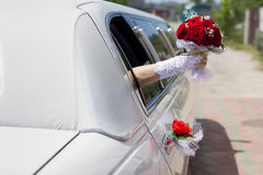 Bridal bouquet in a car window Stock Image