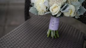 Bridal bouquet on chair stock video footage
