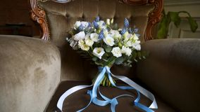 Bridal bouquet on a chair. Bridal bouquet flowers on a chair stock footage
