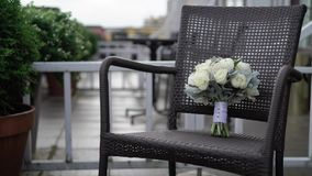 Bridal bouquet on chair stock footage