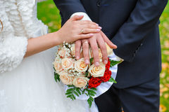 Bridal bouquet close up in the hands of the bride and groom Royalty Free Stock Images