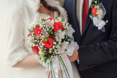 Bridal bouquet close up in the hands of the bride and groom Stock Photo
