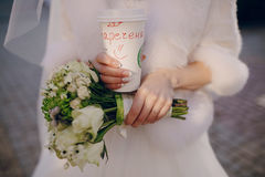 Bridal bouquet and coffee Royalty Free Stock Photography