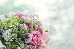 Bridal bouquet with copyspace. Closeup background of a bridal bouquet with lovely pink roses and variegated foliage outdoors with copyspace Royalty Free Stock Photos