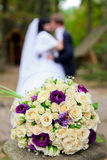 Bridal bouquet and the couple Royalty Free Stock Images