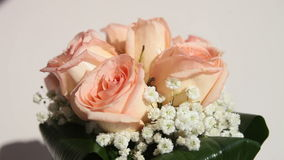 Bridal bouquet of cream roses stock video footage