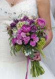 Bridal bouquet of different flowers. In hand of the bride Stock Image