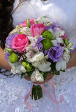 Bridal bouquet of different flowers. In hand of the bride Royalty Free Stock Images