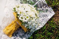 Bridal bouquet on dress Royalty Free Stock Photo