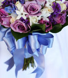 Bridal bouquet of flowers. Bridal bouquet of blue and purple flowers with a blue ribbon Royalty Free Stock Image