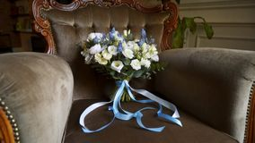 Bridal bouquet on a chair. Bridal bouquet flowers on a chair stock video