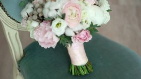Bridal bouquet on a chair. Bridal bouquet flowers on a chair stock video footage