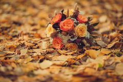 Bridal bouquet flowers closeup. Bridal wedding flowers, closeup on leaves background, autumn royalty free stock images