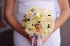 Bridal bouquet of flowers in hands of the bride Royalty Free Stock Image