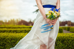 Bridal bouquet of flowers in hands of the bride Royalty Free Stock Photography