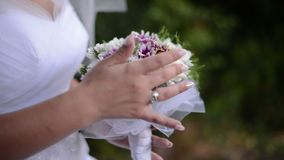 Bouquet of flowers in hands of the bride