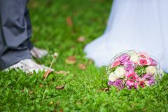 Bridal bouquet. In front of the wedding dress Royalty Free Stock Photography