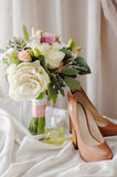 Bridal bouquet. gift bouquet. White and pink flowers on burlap  decorative clot Royalty Free Stock Photos