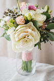 Bridal bouquet. gift bouquet. White and pink flowers on burlap  decorative clot Royalty Free Stock Photo
