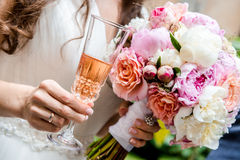 Bridal bouquet and glass of champagne Royalty Free Stock Image