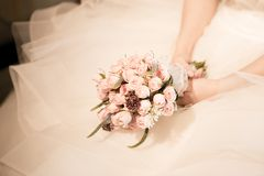 Bridal bouquet and gown Royalty Free Stock Photography