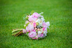 Bridal bouquet on grass Royalty Free Stock Photography
