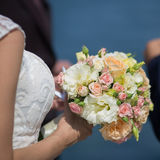 Bridal bouquet in hand of bride Royalty Free Stock Photo