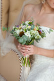 Bridal bouquet in hands. The bride holds a gentle bouquet in hand Royalty Free Stock Photo