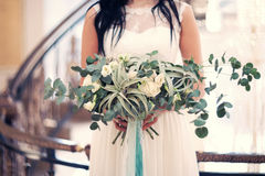 Bridal bouquet in the hands of. Green bridal bouquet in the hands of Royalty Free Stock Photo