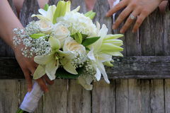 Bridal bouquet in hands of newly married bride Stock Image